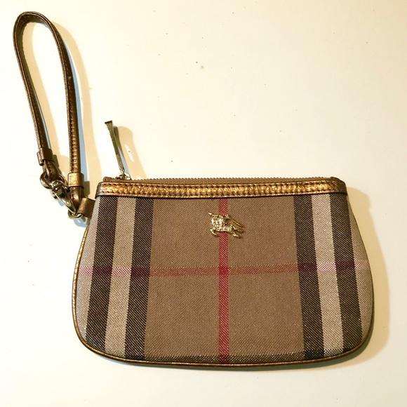 Burberry Handbags - BURBERRY Nova check metallic gold wristlet💋💋 d32cb9d6a97e8